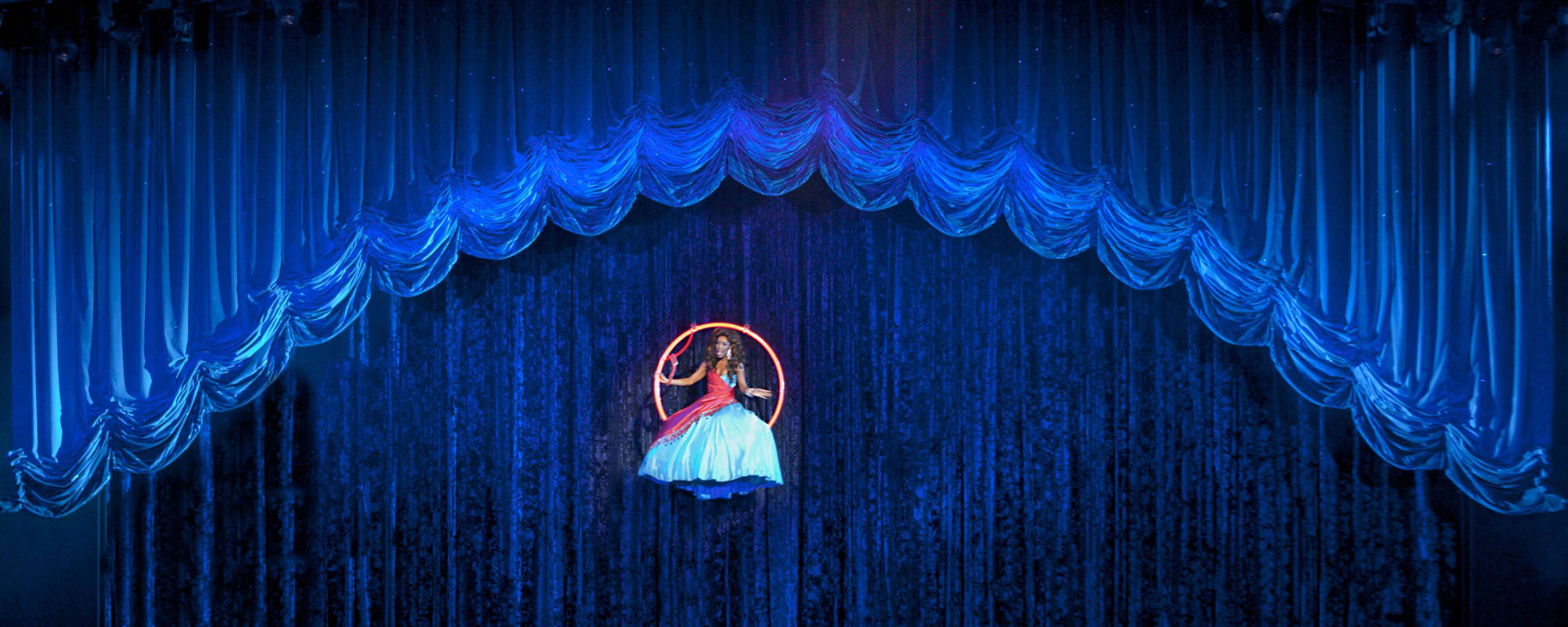 Blue Curtain With Performer