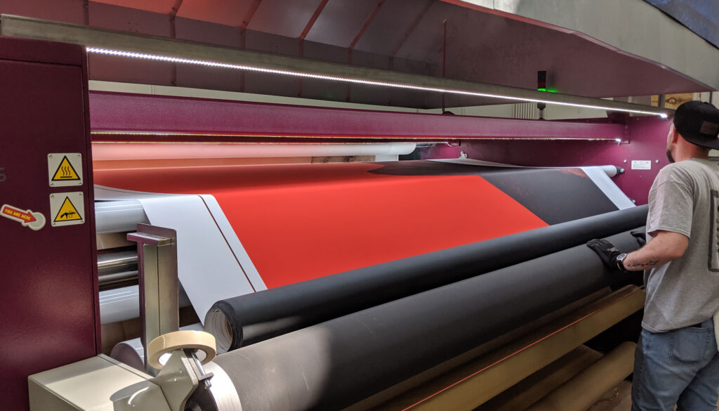 custom printing - large format printers with someone working at them